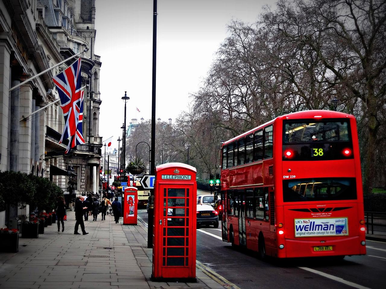 A double decker driving down a London street.