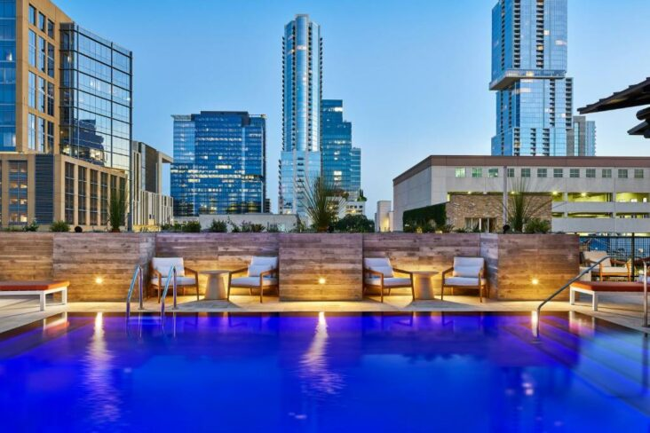 The swimming pool at the Canopy by Hilton Austin Downtown, one of the hotels near Austin Amtrak Station.