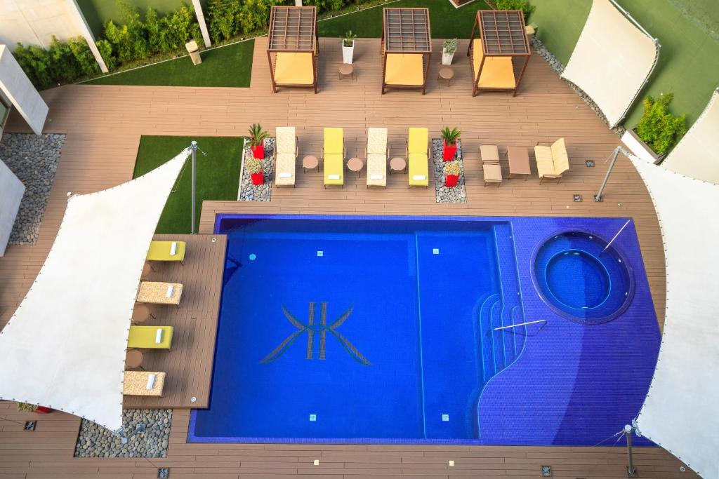 The swimming pool at the Adriatika Hotel Boutique, one of the hotels near La Aurora Airport in Guatemala City.